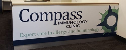 small-slider-reception-signage-compass-immunology